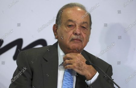 Mexican billionaire Carlos Slim listens to a question during a news conference at his office in Mexico City. Slim's son said, that his father has become infected with COVID-19 but that his symptoms are minor