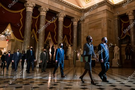 Clerk of the House of Representatives Cheryl L. Johnson, followed by House Speaker Nancy Pelosi's impeachment managers, carry the article of impeachment through Statuary Hall as they pass from the House to the Senate in the US Capitol in Washington, DC, USA, 25 January 2021. Senate Majority Leader Chuck Schumer said the Senate trial against former US President Donald J. Trump, on incitement of a mob attack against the US Capitol, will begin the week of February 08.