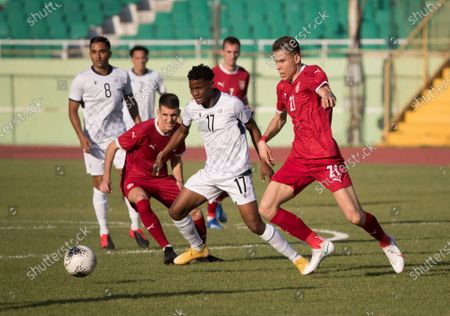 Serbian Alexa Pejic (R) vies for the ball with Dominican Dorny Romero (C) during a friendly match between Serbia and Dominican Republic, at the Felix Sanchez stadium, in Santo Domingo, Dominican Republic, 25 January 2021.