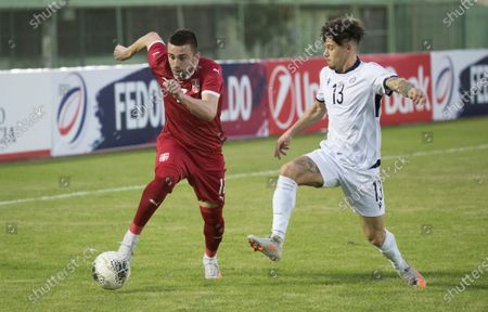 Serbian Nikola Aksentijevic (L) vies for the ball with Dominican Rudolf Gonzalez (R) during a friendly match between Serbia and Dominican Republic, at the Felix Sanchez stadium, in Santo Domingo, Dominican Republic, 25 January 2021.