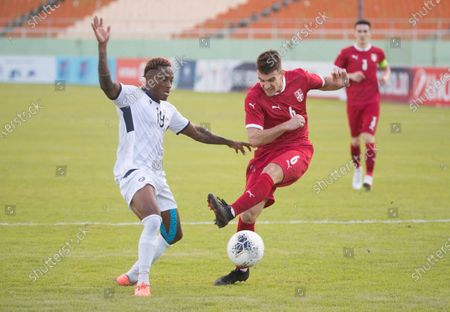 Serbian Jovan Nisic (C) vies for the ball with Dominican Wilman Modesta (L) during a friendly match between Serbia and Dominican Republic, at the Felix Sanchez stadium, in Santo Domingo, Dominican Republic, 25 January 2021.