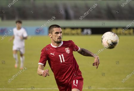 Serbian Milan Vukadinoc controls the ball during a friendly match between Serbia and Dominican Republic, at the Felix Sanchez stadium, in Santo Domingo, Dominican Republic, 25 January 2021.