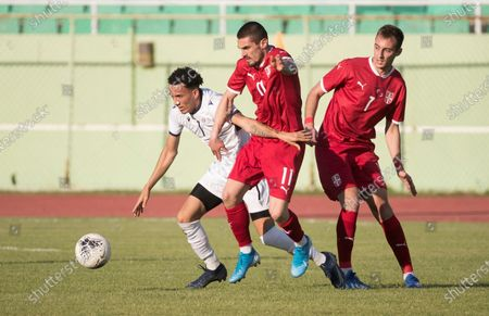 Serbs Milan Vukadinovic (C) and Lazar Tulegdzi (R) vie for the ball with Dominican Edarlyn Reyes (L) during a friendly match between Serbia and Dominican Republic, at the Felix Sanchez stadium, in Santo Domingo, Dominican Republic, 25 January 2021.