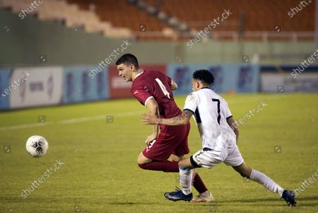 Serbian Ranko Veselinovic (L) in action against Dominican Edarlyn Reyes (R) during a friendly match between Serbia and Dominican Republic, at the Felix Sanchez stadium, in Santo Domingo, Dominican Republic, 25 January 2021.