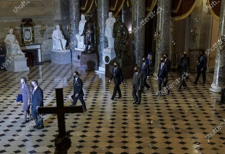 House impeachment managers deliver the single article of impeachment accusing former U.S. President Donald Trump of inciting the January 6, 2021 U.S. Capitol riot that left five people dead in Statuary Hall at the U.S. Capitol on Monday, January 25, 2021 in Washington, D.C. Cheryl Johnson, clerk of the House of Representatives; Timothy Blodgett, acting Sergeant at Arms of the House of Representatives lead the House impeachment managers Reps. Jamie Raskin (D-Md.), Diana DeGette (D-Colo.), David Cicilline (D-R.I.), Joaquín Castro (D-Texas), Eric Swalwell (D-Calif.), Ted Lieu (D-Calif.), Madeleine Dean (D-Pa.) and Joe Neguse (D-Colo.) and Delegate Stacey Plaskett (D-Virgin Islands)] from the House, proceeding through National Statuary Hall and the Capitol. Rotunda to the Senate where the managers will deliver the article of impeachment against former President Donald Trump.