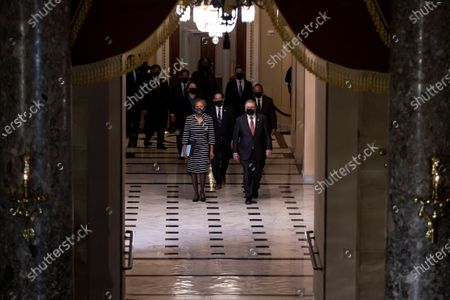 US House Clerk Cheryl Johnson, Rep. Jamie Raskin (D-MD) and House Sergeant-at-Arms Tim Blodgett walk  walk through the Capitol's Statuary Hall to deliver the article of impeachment for incitement of insurrection against former President Donald Trump to the Senate floor in Washington, DC, USA, 25 January 2021. The House impeached former President Donald J. Trump for incitement of insurrection, the Senate trial will begin 08 February.