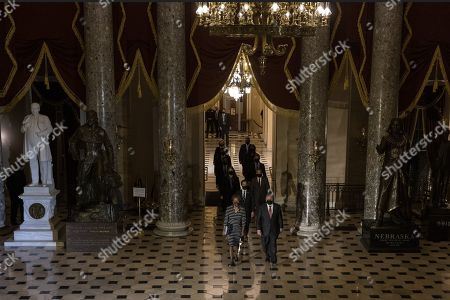 Clerk of the House Cheryl Johnson along with House Sergeant-at-Arms Tim Blodgett lead the Democratic House impeachment managers as they walk through Statuary Hall on Capitol Hill to deliver to the Senate  the article of impeachment alleging incitement of insurrection against former President Donald Trump