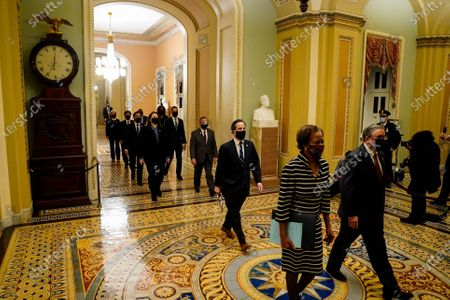 House Clerk Cheryl L. Johnson (2-R) and acting House sergeant-at-arms Timothy P. Blodgett (R) lead House impeachment managers to deliver to the Senate an article of impeachment accusing former president Donald Trump of 'incitement of insurrection',  in Washington, DC, USA, 25 January 2021.