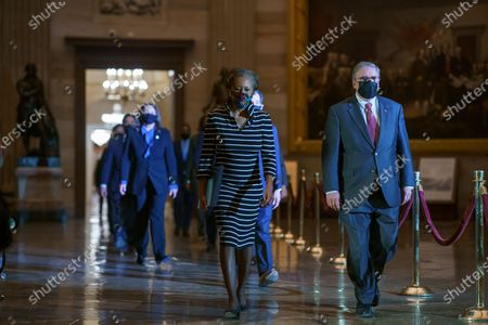 Clerk of the House Cheryl Johnson along with acting House Sergeant-at-Arms Tim Blodgett lead the Democratic House impeachment managers as they walk through Statuary Hall on Capitol Hill to deliver to the Senate the article of impeachment alleging incitement of insurrection against former President Donald Trump, in Washington,.