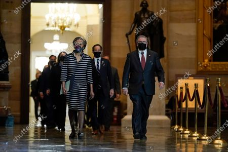 Stock Image of Clerk of the House Cheryl Johnson along with House Sergeant-at-Arms Tim Blodgett lead the Democratic House impeachment managers as they walk through Statuary Hall on Capitol Hill to deliver to the Senate the article of impeachment alleging incitement of insurrection against former President Donald Trump, in Washington,.