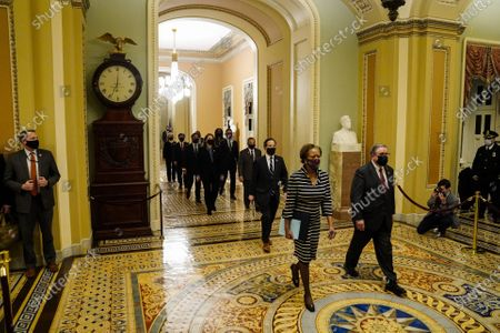 Stock Photo of Clerk of the House Cheryl Johnson along with House Sergeant-at-Arms Tim Blodgett lead the Democratic House impeachment managers as they walk through Statuary Hall on Capitol Hill to deliver to the Senate  the article of impeachment alleging incitement of insurrection against former President Donald Trump