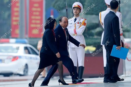 Vietnam's Prime Minister Nguyen Xuan Phuc, second left, arrives for the opening ceremony of the 13th National Congress of Vietnam's Communist Party (VCP), in Hanoi, Vietnam