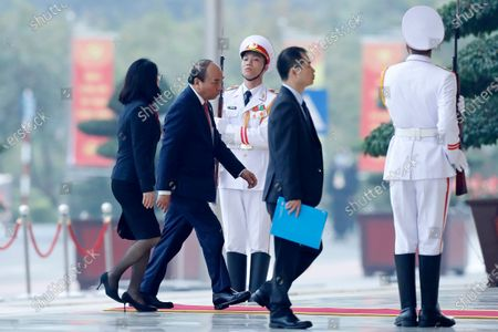 Vietnam Prime Minister Nguyen Xuan Phuc, second left, arrives at the national convention center to attend the 13th Communist Party Congress in Hanoi, Vietnam . Vietnam's ruling Communist Party has begun a crucial weeklong meeting in the capital Hanoi to set the nation's path for the next five years and appoint the country's top leaders