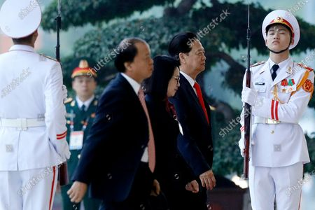Stock Picture of Former Vietnam's Prime Minister Nguyen Tan Dung, second right, arrives for the opening ceremony of the 13th National Congress of Vietnam's Communist Party (VCP), in Hanoi, Vietnam