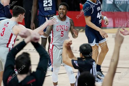UNLV's David Jenkins Jr. (5) celebrates after a play against Utah State during the second half of an NCAA college basketball game, in Las Vegas