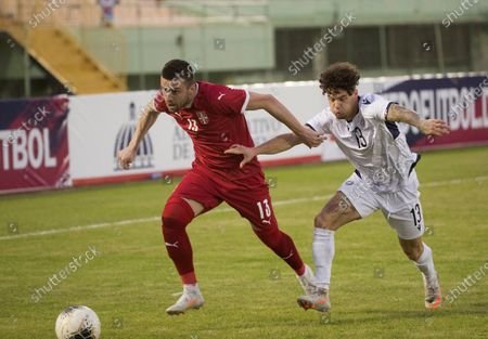 Serbian Nikola Aksentijevic (L) in action against Dominican Rudolf Gonzalez (R) during a friendly match between Serbia and Dominican Republic, at the Felix Sanchez stadium, in Santo Domingo, Dominican Republic, 25 January 2021.