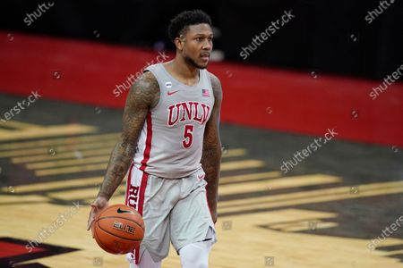 UNLV's David Jenkins Jr. (5) plays against Utah State in an NCAA college basketball game, in Las Vegas