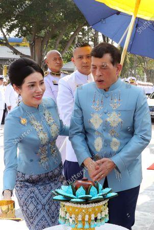 Thai King Maha Vajiralongkorn Bodindradebayavarangkun (R) accompanied by the Royal Consort Sineenat Wongvajirapakdi (L) attend a merit-making ceremony to mark the Royal Consort's birthday at Wasukri pier in Bangkok, Thailand, 26 January 2021. Thai Royal Consort Sineenat was born on 26 January 1985.
