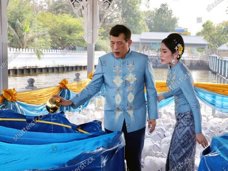 Thai King Maha Vajiralongkorn Bodindradebayavarangkun (L) accompanied by the Royal Consort Sineenat Wongvajirapakdi (R) attend a merit-making ceremony to mark the Royal Consort's birthday at Wasukri pier in Bangkok, Thailand, 26 January 2021. Thai Royal Consort Sineenat was born on 26 January 1985.