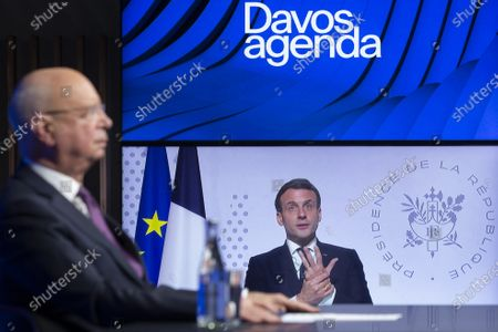 German Klaus Schwab (L), Founder and Executive Chairman of the World Economic Forum, WEF, listens French President Emmanuel Macron displayed on screen during a videoconference at the Davos Agenda, in Cologny near Geneva, Switzerland, 26 January 2021. The Davos Agenda is taking place from 25 to 29 January 2021 as an online edition due to the coronavirus disease (COVID-19) pandemic.