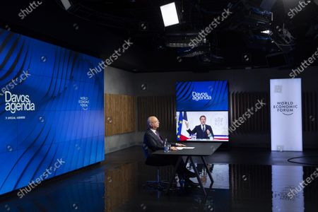 German Klaus Schwab (L), Founder and Executive Chairman of the World Economic Forum, WEF, listens to French President Emmanuel Macron displayed on screen during a videoconference at the Davos Agenda, in Cologny near Geneva, Switzerland, 26 January 2021. The Davos Agenda is taking place from 25 to 29 January 2021 as an online edition due to the coronavirus disease (COVID-19) pandemic.