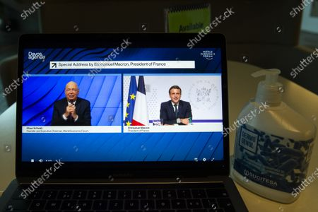 A screen shows German Klaus Schwab (L), Founder and Executive Chairman of the World Economic Forum, WEF, talking with French President Emmanuel Macron during a videoconference at the Davos Agenda, in Cologny near Geneva, Switzerland, 26 January 2021. The Davos Agenda is taking place from 25 to 29 January 2021 as an online edition due to the coronavirus disease (COVID-19) pandemic.