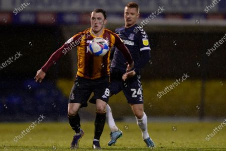 Jason Demetriou of Southend United and Callum Cooke of Bradford City in action during Sky Bet League Two match between Southend United and Bradford City at Roots Hall in Southend - 26th January 2021