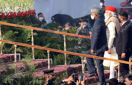 Indian Prime Minister Narendra Modi (C) and Indian President Ram Nath Kovind arrive during the 72nd Republic Day celebrations in New Delhi, India, 26 January 2021. The Republic Day of India marks the adoption of the constitution of India and the transition of the country to a Republic on 26 January 1950.