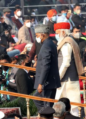 Indian Prime Minister Narendra Modi (R) and Indian President Ram Nath Kovind arrive during the 72nd Republic Day celebrations in New Delhi, India, 26 January 2021. The Republic Day of India marks the adoption of the constitution of India and the transition of the country to a Republic on 26 January 1950.