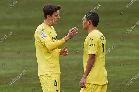 Pau Torres and Carlos Bacca of Villarreal CF