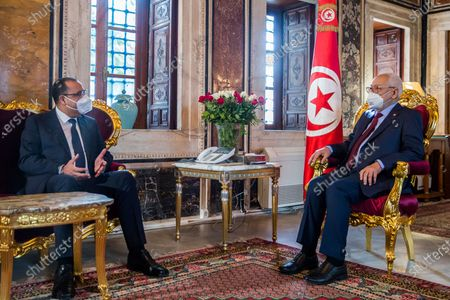 Tunisian Prime Minister Hichem Mechichi, left, talks with housespeaker Rached Ghannouchi, before the government faces a confidence vote, Tuesday, Jan.26, 2021 at the Parliament in Tunis. Tunisians are marching on their heavily guarded parliament Tuesday as lawmakers vote on a new government, after a week of youth protests and riots over poverty and lack of jobs that left one young demonstrator dead and hundreds jailed. Prime Minister Hichem Mechichi announced a government reshuffle last week in the midst of the unrest