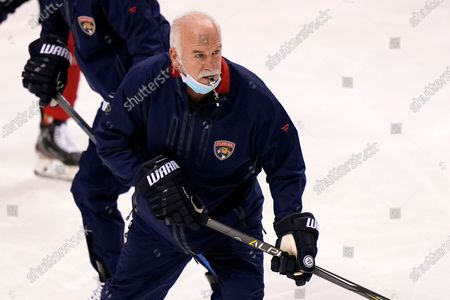 Florida Panthers heads coach Joel Quenneville works with players during NHL hockey training camp, in Sunrise, Fla