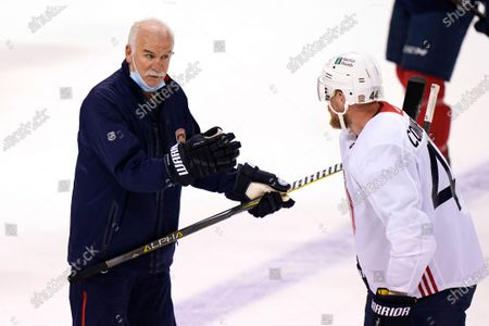 Stock Picture of Florida Panthers heads coach Joel Quenneville, left, talks with defenseman Kevin Connauton during NHL hockey training camp, in Sunrise, Fla