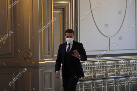 French President Emmanuel Macron, arrives to attend a video conference at the Elysee Palace in Paris, with German Klaus Schwab, Founder and Executive Chairman of the World Economic Forum, WEF, at the Davos Agenda in Geneva. The Davos Agenda from Jan. 25 to Jan. 29, 2021 is an online edition due to the coronavirus disease (COVID-19) outbreak