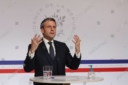 French President Emmanuel Macron, attends a video conference at the Elysee Palace in Paris, with German Klaus Schwab, Founder and Executive Chairman of the World Economic Forum, WEF, on a video screen at the Davos Agenda in Geneva. The Davos Agenda from Jan. 25 to Jan. 29, 2021 is an online edition due to the coronavirus disease (COVID-19) outbreak