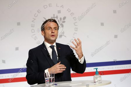 French President Emmanuel Macron attends a video conference at the Elysee Palace in Paris, France, 26 January 2021, with German Klaus Schwab, Founder and Executive Chairman of the World Economic Forum (WEF) at the Davos Agenda in Geneva. The Davos Agenda from 25 to 29 January 2021, is an online edition due to the coronavirus disease (COVID-19) pandemic.