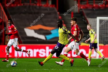 Mouhamadou-Naby Sarr of Huddersfield Town is challenged by Chris Martin of Bristol City
