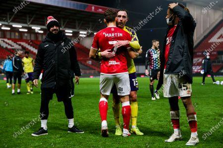 Chris Martin of Bristol City and Richard Keogh of Huddersfield Town after Bristol City win 2-1