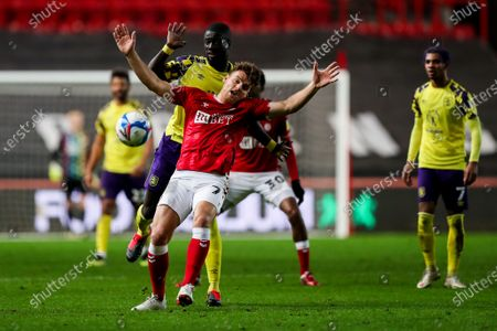 Chris Martin of Bristol City is challenged by Mouhamadou-Naby Sarr of Huddersfield Town