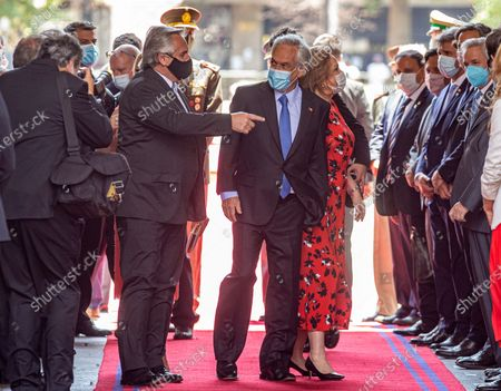 Argentina's President Alberto Fernandez points as Chile's President Sebastian Pinera receives him at La Moneda presidential palace in Santiago, Chile, . Fernandez is on an official visit to Chile for two days