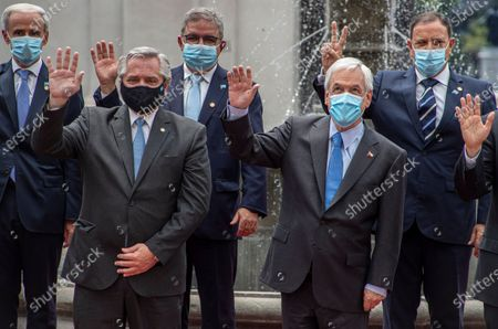Argentina's President Alberto Fernandez, front left, and Chile's President Sebastian Pinera waves during a group photo after giving a joint statement at La Moneda presidential palace in Santiago, Chile, amid the COVID-19 pandemic. Fernandez is on an official two-day visit to Chile