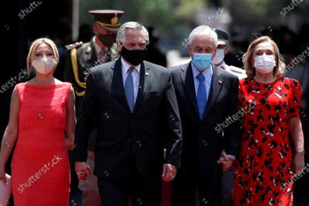President of Chile Sebastian Pinera (2R), accompanied by the Chilean first lady Cecilia Morel (R) receives Argentinian President Alberto Fernandez (2L) and the Argentinian first lady Fabiola Yanez (L) at the La Moneda Palace, in Santiago, Chile, 26 January 2021 at the La Moneda Palace, in Santiago, Chile, 26 January 2021. Fernandez arrived in Santiago with the Argentinian first lady Fabiola Yanez and a delegation of ministers, provincial governors and legislators, 'with the aim of advancing in the signing of agreements in various areas of work and strengthening the bilateral relationship,' sources reported.