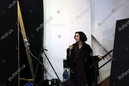 Stock Picture of Model Angeliki Tsionou takes a break during the shoot for Julien Fournie's Haute Couture Spring/Summer 2021 fashion collection for a digital presentation of the fashion week, in Paris, . With shows taking place behind closed doors due to the virus pandemic, some designers such as Julien Fournie are becoming versatile: Getting their designs out to the public by making a film of their collection and streaming it online
