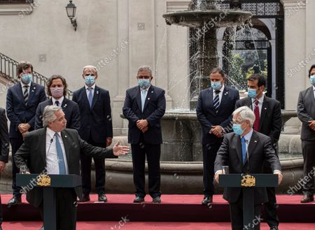 Argentina's President Alberto Fernandez, left, talks as he looks at Chile's President Sebastian Pinera during a joint statement at La Moneda presidential palace in Santiago, Chile, amid the COVID-19 pandemic. Fernandez is on an official two-day visit to Chile