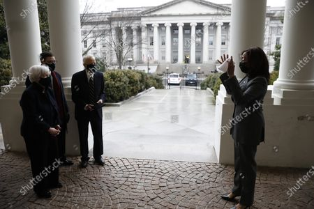 US Treasury Secretary Janet Yellen (L) is sworn in next to her husband George Akerlof and son Robert Akerlof by US Vice President Kamala Harris at the White House in Washington, DC USA, 26 January 2021.