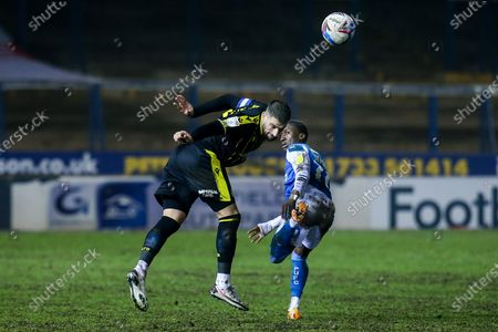 Max Ehmer of Bristol Rovers heads the ball