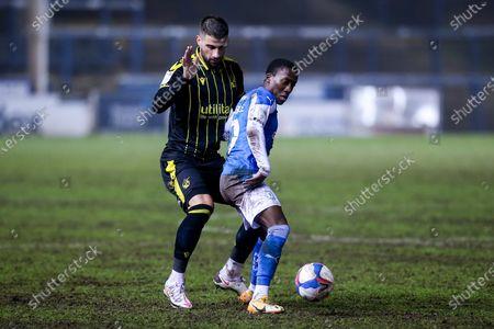 Siriki Dembele of Peterborough United takes on Max Ehmer of Bristol Rovers
