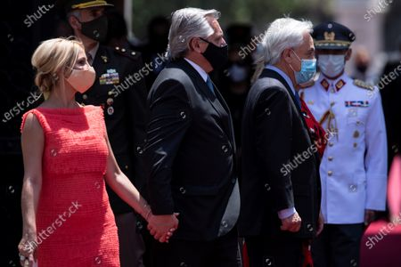 President of Chile, Sebastian Pinera (2R), accompanied by the Chilean first lady, Cecilia Morel (unseen), receives his Argentinian counterpart, Alberto Fernandez (2L), and the Argentinian first lady, Fabiola Yanez (L), at the La Moneda Palace, in Santiago, Chile, 26 January 2021. Fernandez arrived in Santiago with the Argentinian first lady, Fabiola Yanez, and a delegation of ministers, provincial governors and legislators, 'with the aim of advancing in the signing of agreements in various areas of work and strengthening the bilateral relationship,' sources reported.