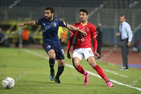 Al-Ahly player Taher Mohamed (r) in action against Pyramids player Ahmed Fathi (L) during the Egyptian  Premier League soccer match between Al-Ahly and Pyramids at June 30 Stadium in Cairo, Egypt, 26 January 2021.