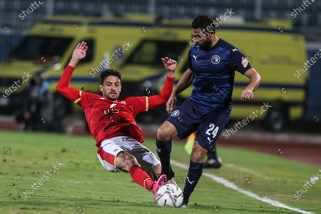Pyramids player Ahmed Fathi (r) in action against Al Ahly player Taher Mohamed (L) during the Egyptian Premier League soccer match between Al-Ahly and Pyramids at June 30 Stadium in Cairo, Egypt, 26 January 2021.